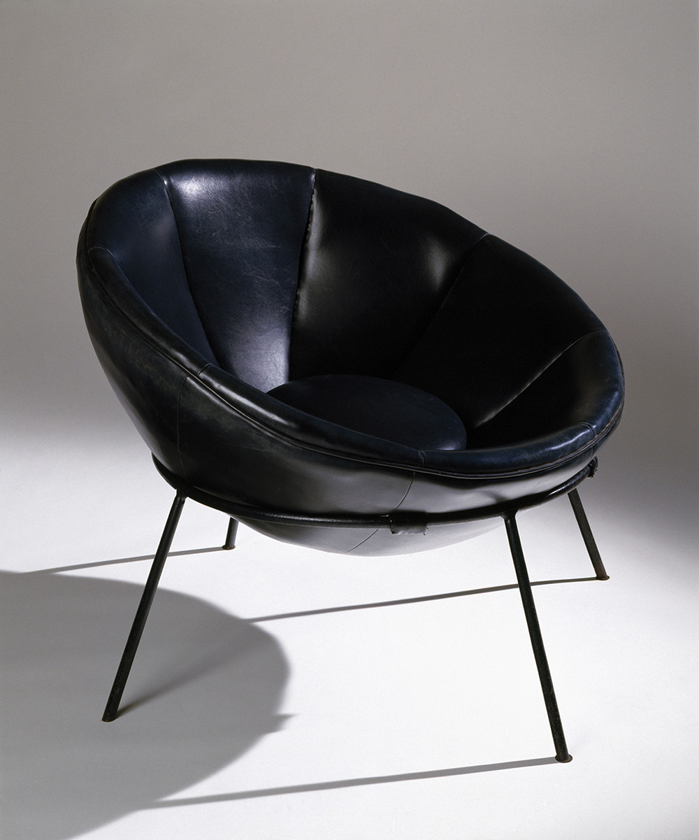 Lina Bo Bardi, Bardi Bowl chair in steel and leather, c. 1951.  Photo by Nelson Kon.